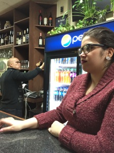 Mariel Santos working in a Dominican-styled restaurant in the Bronx.